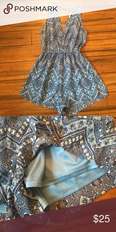 Beautiful romper Beautiful blue romper. This romper is somewhat sheer on the top and has built in liner on the bottom half. Looks amazing paired with a lace bralette. Excellent condition. I think it fits more like a medium. Other