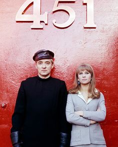 Oskar Werner and Julie Christie, beneath a large 451 sign, issued as publicity for the film, Fahrenheit 451, in 1966. The science-fiction film, directed by François Truffaut was adapted from the novel by Ray Bradbury