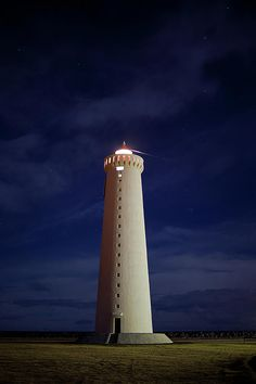 #Lighthouse Against Sky With Stars Fine Art Print