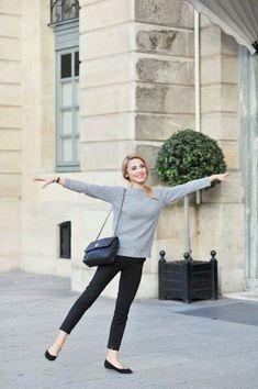 Black pants, black flats, gray sweater, pretty hair, Chanel bag.