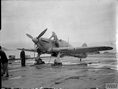A Hawker Sea Hurricane of the Royal Navy is refueled on the flight deck of the HMS Argus (Imperial War Museum Photograph. Luftwaffe, Ww2 Aircraft, Military Aircraft, Royal Navy Aircraft Carriers, Ww2 Photos, Ww2 Pictures, Hawker Hurricane, Ww2 Planes, Flight Deck