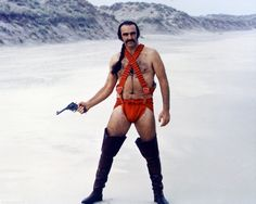 Picture of Sean Connery in Zardoz with long black hair and high leather boots wearing a red panties. Sean Connery dans Zardoz porte de grandes bottes noires avec un slip rouge John Boorman, Film Science Fiction, Fiction Film, Fan Fiction, Charlotte Rampling, Arcade Fire, Demotivational Posters, Daniel Craig, Actors