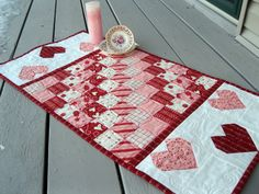 Sweet  Hearts 16 x 32 Valentine quilted table runner. $42.00, via Etsy.