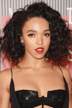 FKA ditched her typical braided styles for a curly, natural look. But she didn't stray from her signature bold brows and septum ring.