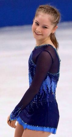 Yulia Lipnitskaia...LOOOOOOOOOVE HER HAIR!!!!!!!!!!!!!!!!!!!!!!!!!!!!! I think it is just a headband french braid pulled back into a ponytail...MAYBE!!! :P :P :P (also LOOOVE HER DRESS!!!!!)