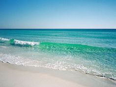 A wave as clear and sparkling as a gem rolls in along Florida's Emerald Coast, a stretch of beautiful water and beaches from around Panama City to Pensacola.