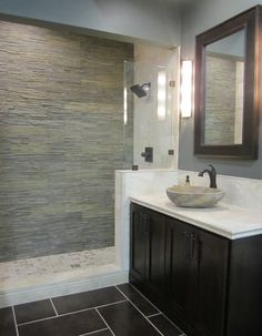 slate, travertine and porcelain bathroom
