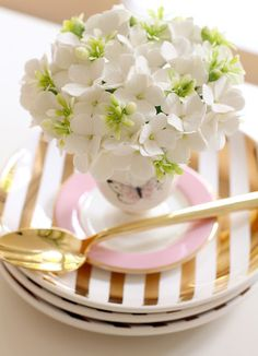 Place Setting idea ~ flowers arranged in an egg cup
