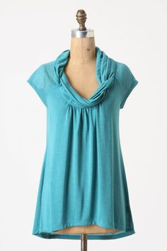 This top uses two fabrics: a solid knit (for the body) and sheer knit (for sleeve).  Both fabrics are twisted to form the collar (have to look closely on this aqua top; more obvious on fuchsia top visible on the Anthropologie site 1/14/13).