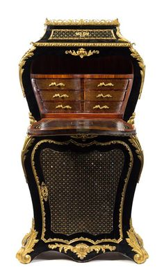 A Napoleon III Gilt Bronze Mounted Brass and Mother-of-Pearl Inlaid Ebonized Secretaire a Abattant third quarter 19th century.