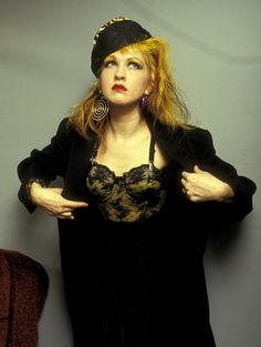 A black skirt and jacket keeps all attention on Cyndi's corset top. via @AOL_Lifestyle Read more: http://www.aol.com/article/2013/06/22/cyndi-laupers-style-transformation/20630043/?a_dgi=aolshare_pinterest#slide=12476