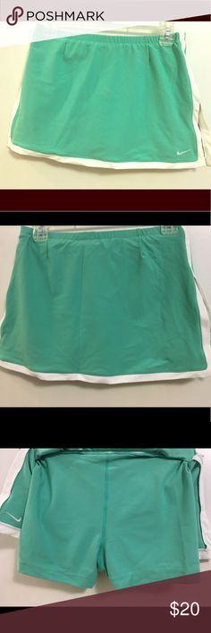 Brand NWT Mint Green Nike Tennis Skirt NWT, never worn mint green and white dry fit nike tennis skirt size XS. See my closet for matching dry fit white and teal top. Nike Skirts