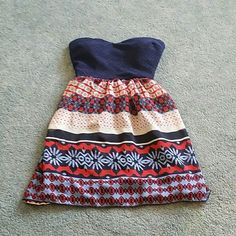 Strapless Dress with cute opening in the back. Strapless Dress with cute opening in the back. This dress is super cute and can be worn with a belt. Only worn once. City Triangles Dresses Strapless