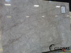 Cristallo Quartzite. This is a translucent material, white background with light red veining. Visit globalgranite.com for your natural stone needs.
