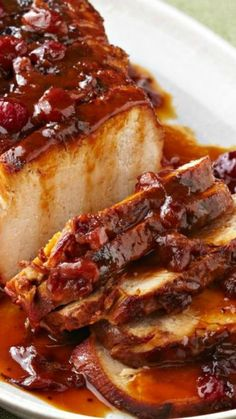 Slow-Cooker Cranberry-Orange Pork Roast ~ Cranberry sauce and the juice and zest of an orange work their tasty magic in the slow cooker so you can come home to a sweet and tart roast pork loin.