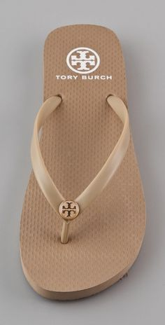 I want these badly!!!  Sandy colored Tory Burch flip flops!  Perfect for our destination wedding!  I could wear them with every single outfit!!!