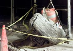 A tire from one of the hijacked planes lies in the street near the destroyed World Trade Center in New York City, on September 11, 2001.