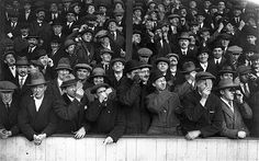 Soccer Eclipse, April 4, 1936 Spectators at Upton Park take a moment during the football between West Ham United & Aston Villa to view the eclipse of the sun during play.