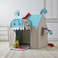 We can't legally recommend walking into the mouth of a giant monster. However, if that monster isn't real, and is actually just a giant playhouse designed by artist John Murphy, then we say go for it. This exclusive playhouse is ready to come home with you, and it's sure to give the monsters under your bed a run for their money.