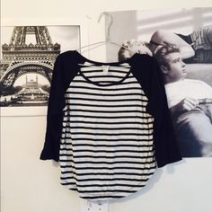 Black and White Striped Baseball Tee Wore one time. Black and white striped design. Solid black sleeves. Baseball tee style. Runs small. From Forever 21. Forever 21 Tops Tees - Long Sleeve