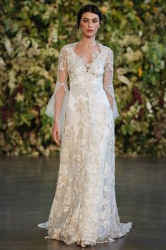 A romantic lace wedding dress with illusion sleeves. Claire Pettibone, Fall 2015