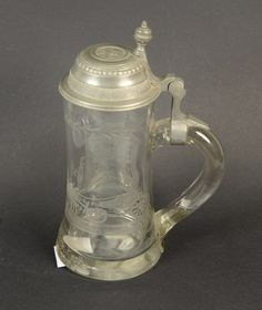 Antique glass pitcher, with eingeschliffenem Hochzeitsmotiv, tin top, added to handle, German, about 1900, contents: approximate 0, 5 liter, H = 22, 0cm