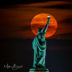 Beautiful shot of the Hunter's Moon behind the Statue of Liberty in New York City. (Photo Credit: instagram.com/mikebissel) #supermoon #huntersmoon