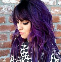 Layered purple hair with shaggy bangs