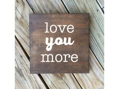 Love you more wood sign, wood sign, wooden art, hand painted sign, wall decor, home decor, love art, love sign, love quote by LifeLessOrdinaryShop on Etsy https://www.etsy.com/listing/456867360/love-you-more-wood-sign-wood-sign-wooden