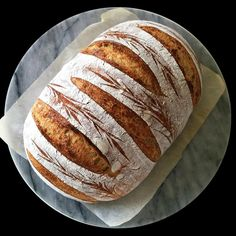 25% freshly milled wholewheat, 10% whole spelt at 80% hydration. Combining stencils with one of my favorite scoring patterns. I like it because it is effective but, with no angled or curved cuts, it's so easy even on higher hydration loaves. Last weekend I was at the LA Shag Festival. Yep, that's right my British friends, a festival where you go around asking people if they'd like to shag . For those of you who are unfamiliar with it, shag belongs to the swing family of dances originating…