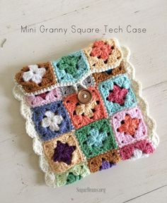 This week, I have transformed a pile of mini  granny squares into a sweet & colorful Tech Case.   I used my very favorite cotton yarn from Hobby Lobby {I Love This Cotton}  This photo shows the backside of the granny squares connected with a single  crochet stitch.   Tutorial:     1. Make a two round mini granny square.     2. Connect the mini squares in a three row pattern using a single...