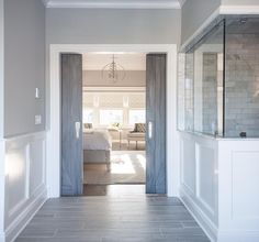 Cory Connor Design - bathrooms - Benjamin Moore - San Antonio Gray - Gray barn doors, interior barn doors, subway tile, gray tile, wood like...
