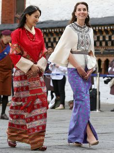 Britain's Prince William and Catherine, Duchess of Cambridge walk with King Jigme Khesar Namgyel Wangchuck and Queen Jetsun Pema from a Buddhist Temple inside the Tashichodzong in Thimphu on April 14, 2016, during the first day of a two visit of the British Royal Couple to Bhutan. The Duchess looked beautiful in a traditional-looking ensemble. Kate wore the Embroidered Wool Cape by PAUL & JOE. Kate's beautiful lavender skirt was made by her unidentified designer in London using fabric woven…