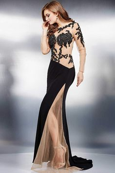 Black and nude floor length long sleeve gown features beaded adornments, a sheer…