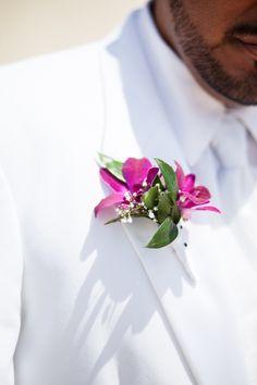 Pink orchid boutonniere, groom in white tuxedo, groom on beach, formal beach wedding, New London, CT, Ocean Beach Park