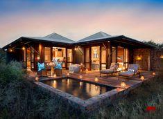 """Die luxuriöse Kwandwe Ecca Lodge liegt im malariafreien Kwandwe Wildreservat. Erleben Sie eine einmalige """"Big Five""""-Safari in Südafrikas Eastern Cape."""