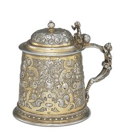 JOHANN CHRISTOPH TREFFLER I GERMAN PARCEL-GILT SILVER TANKARD, flat-chased with strapwork, marked on body and cover, Augsburg, 1717-1721
