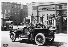 Tow Truck with Holmes boom assembly.Great vintage photo.