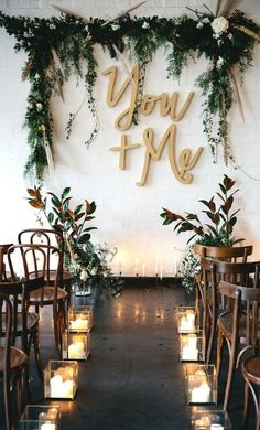 15 Gorgeous Indoor Wedding Backdrops To Try: attach calligraphy letters, greenery and blooms right to the white wall to make a cool backdrop; #weddingdecor
