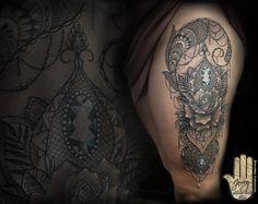 Rose thigh tattoo by Jerry Dzeraldas Kudrevicius, pretty lace tattoo idea.