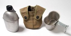 U.S. Marine Corps canteen set made by the Foley Manufacturing Company of Minneapolis, Minnesota in 1944.  The set consists of a galvanized steel  canteen, cup, and canvas cover.