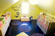 colorful slanted ceiling with painted wood floors for upstairs playroom!