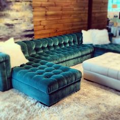 chesterfield sofa in great aqua color and with nice low lines like an Italian design. From American Leather