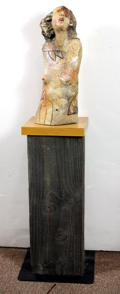 """Mike Moran (American, Contemporary), Singing Woman Torso, 2009, glazed ceramic sculpture mounted on wood stand and pedestal, dated and signed verso, sculpture: 20""""h x 8""""w x 5.5""""d, overall (with base and pedestal): 49""""h x 14""""w x 14""""d"""