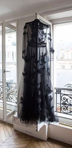 Halloween style!! Just the right black overdress or gown - just add a black satin slip dress! Embroidered with black butterflies or moths! So pretty!
