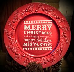 This beautiful 13 inch charger plate is a beautifully festive & cheerful red and has a raised holly design around the rim. Decoration is in white and your c