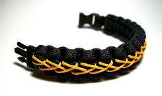 Navy blue and orange center stitched paracord bracelet