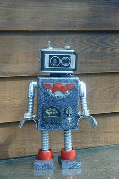 Robots are a common theme when creating technology art. You can take any sort of technology scrap and turn it into a cute little robot like this and put him on display in your home!