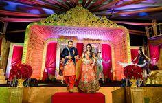 An orange kurta and pyjama with a navy blue overlapping jacket for the Sanget of Groom Vijay of WeddingSutra. Photo Courtesy- Colomono