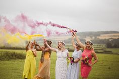 Mismatched Bridesmaid Dresses Smoke Bombs Eclectic Whimsical Village Hall Wedding http://www.nicolacasey.photography/